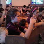 students_praying_in_church